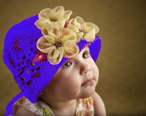 Close Up Cute Baby Girl Flowers on Crocheted Hat