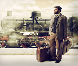 Emigrant to the train station with cardboard suitcases.
